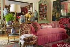 The elaborate home where decorator and designer Michelle Nussbaumer and her businessman husband, Bernard, live is abound with a high-energy blend of pattern and color distinguishedby bonny pinks. The 19th-century English sofa is in a Ralph Lauren Home linen, the 19th-century French chair is in a Michelle Nussbaumer fabric and the screen and lamp is from Ceylon et Cie.