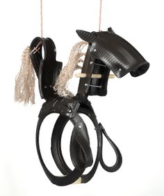There's a reason why generations have enjoyed the simple pleasure of a tire swing hanging from an old oak tree. The ultimate in classic backyard entertainment, this pony-shaped swing makes it easy to enjoy gentle spring breezes and mild weather. Weight capacity: 200 lbs.32'' W x 64'' HRubber / rope / wood