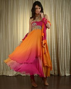 you won't be missed in this gorgeous ombre marigold, orange, and fuchsia layered suit by Kisneel by Pam Mehta