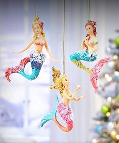 Christmas mermaid design ornaments with cord hangers, sequin pearl and glitter accents. 1 each of 3 Assorted Designs Size: 5 inches tall Materials: Polyresin Mermaid Tale, Mermaid Diy, Vintage Mermaid, Vintage Christmas Ornaments, Christmas Tree Toppers, Christmas Baubles, Xmas, Fantasy Mermaids, Unicorns And Mermaids