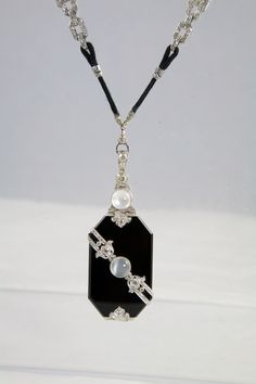 Extraordinary Art Deco Onyx Moonstone Diamond Locket | From a unique collection of vintage drop necklaces at http://www.1stdibs.com/jewelry/necklaces/drop-necklaces/
