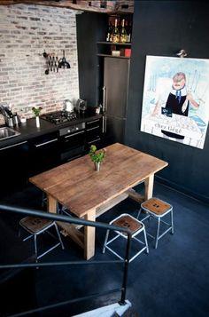 Black+stylish+kitchen+with+fun+wall+art+-+industrial+interior+design