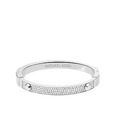 Stack your arm with standout sparklers like our cult-favorite Astor bracelet. Perfectly embellished with the prettiest pavé detail, this silver-tone piece will be a dazzling addition to a wrist full of mix-and-match metallics. Wear it to add an instant dose of glamour to any outfit, piling it up with an oversized watch and studded bangle for a rock-chic finish.