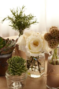 Plants in Mason Jars. Show off the double meaning of the green theme in reused vintage jars with lovely live plants and flowers.