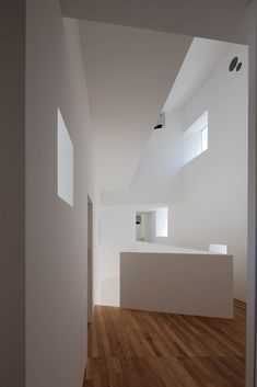 ANGLE is a minimal residence located in Fukuoka, Japan, designed by Hiroyuki Arima + Urban Fourth. The house centers around the courtyard, which features a selection of attractive trees such as oak, maple, katsura, and ash, and is designed so that it is disconnected from the outside world.