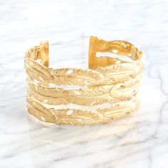 Alexandra Margnat feather cuff available on Les trouvailles d'Elsa.fr