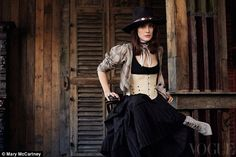 Downton star Michelle Dockery rocks a corset for Vogue shoot #dailymail
