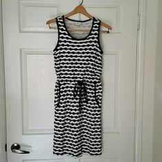 ECI black and white dress w/pockets This black and white dress has a super cool texture to it. It has pockets! There is no slit in the back. The waist ungathered is 13. From the top of the shoulder to bottom length is 38. ECI Dresses