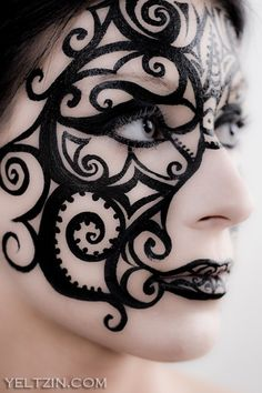 Intricate Steampunk makeup for cosplay or masquerade . Could be good for a dark elf.