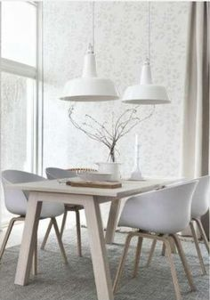 Cool white with blonde wood and just a hint of pattern on the wallpaper ... contemporary Scandinavian chic at its best.