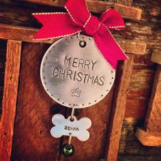 For the pet lover in your life. 2 inch aluminum disc, hand stamped with Merry Christmas and a paw print. Aluminum bone shaped disc with hand stamped pet name and hanging jingle bell. Red Velvet Bow to finish it off. Great gift idea!