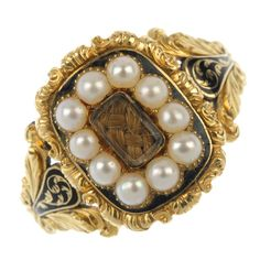 An early 19th century 18ct gold seed pearl and enamel memorial ring