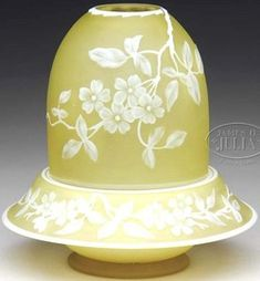 lighting, England, An English Cameo fairy lamp, white cameo floral decoration on a citron background. Shade has four flower blossoms with leaves and branches. MAtching base has five floral blossoms, leaves, branches and butterfly. Circa 1850-1900