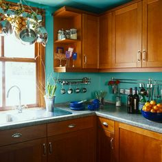 Wood Cabinets and Turquoise Walls in Kitchen - my kitchen is currently this color. Turquoise Kitchen Cabinets, Teal Kitchen Walls, Turquoise Kitchen Decor, Turquoise Walls, Kitchen Wall Colors, Wood Kitchen Cabinets, Painting Kitchen Cabinets, Kitchen Paint, Kitchen Backsplash