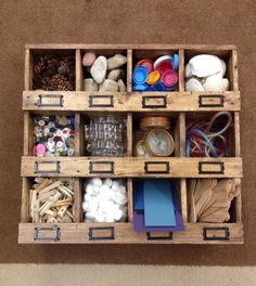 Loose parts: pinecones, rocks, lids, shells, buttons, coasters, tubing/rope, clothespins, cotton balls, mat board and Popsicle sticks