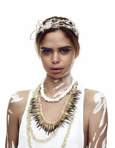 Aboriginal model Samantha Harris - ambassador for Australian Indigenous Fashion Week wearing fibrework and shell / echidna quill necklaces and headdress by Aboriginal designers artists and makers.