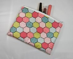 This is a lovely little make up bag or pencil case that has been made with pink fabric with a hexagonal patchwork effect and it is fully lined with waterproof fabric. If you require more than one bag/case, please ask and I will adjust the stock levels . More Than One, One Bag, Waterproof Fabric, Pink Fabric, Pencil, Make Up, August 2013, Angels, Handmade