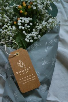 Branding for Rooted Flowers by The Homegrown Studio - flower farm, branding, packaging, floral, flower wrap, bouquet, kraft tag, hang tag, tissue paper, delicate, feminine, elegant, bridal, botanical, rustic, farm