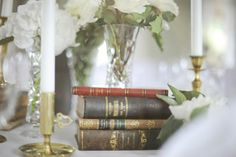 #weddingidea Pairing old books with textured white flowers lends the décor a fresh yet vintage flair. #weddings #weddinginspiration Hanna and Kenny's Dreamy Swedish Summer Wedding feat. in Love Inc. Magazine