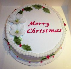 Beautiful White Christmas cake with holly flowers