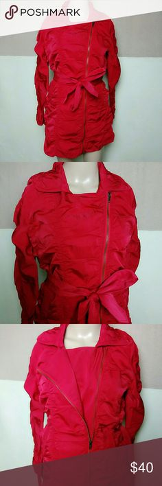 "Red ruched lightweight belted jacket Brand new from vendor with tags.  Polyester cotton blend.  Belted waist, zip front, buckles at arms Lightweight Size small Chest armpit to armpit 17"" Length 30 1/2"" Sleeves 17"" Measurements are approximate and taken while flat. Fresh Mint Jackets & Coats"