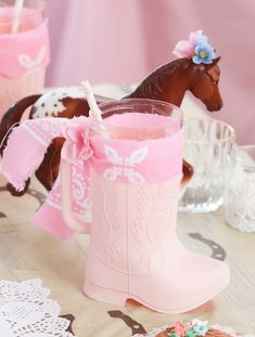 How to create the cutest pink boot drink cups for a Rustic Horse Themed Party, perfect for little cowgirls! Get details and more cowgirl party inspiration now at fernandmaple.com!