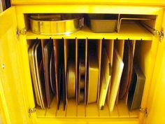 Hubby made two of these in my almost useless kitchen cabinets.  WOW...these organize a lot of cookie sheets, cutting boards and cooling racks!  He did some wider ones for my baking pans.  On top is just the right size for my cornbread pan and waffle iron.  I LOVE IT SO MUCH.