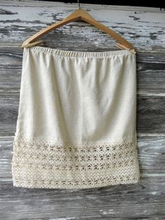 This Extender is made of All Natural Osnaburg Fabric and Natural Lace Trim.  We love our half slips under mini dresses, or your skirt for a fun and flirty Lace Layered look.