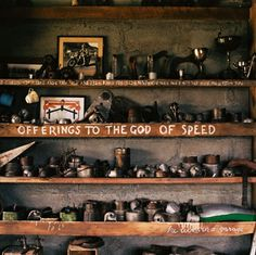 Scene showing shelves in Burt Munro's shed with failed engine parts.