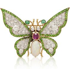 AN ANTIQUE GEM-SET BUTTERFLY BROOCH - Set with an oval cabochon opal and cushion-cut ruby body, extending old European-cut diamond and demantoid garnet wings, diamond collet eyes and emerald collet antennae, mounted in platinum and gold, circa 1890's
