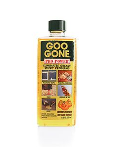 Goo Gone    Goo Gone, an acetone-free solvent, eliminates all traces of manufacturer's labels or adhesive tags without staining. The citrus-scented product also removes gum, crayon marks, and grease from almost any material, including upholstery, carpet, wood, glass, and most fabrics.