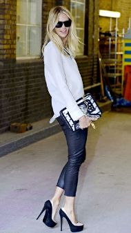 Leather leggings and loose white blouse