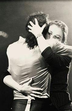 Michael hugging a fan.