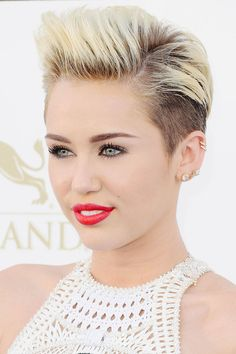 """""""Tick tock tick tock,"""" Cyrus wrote to her Twitter fans, only a short time before posting a photo of hairstylist Chris McMillan about to chop off her girl-next-door locks. The big reveal was a drastic bleached pixie cut with shaved sides and long bangs that sent the social space into a frenzy. But the singer stood by her look. """"Never felt more me in my whole life,"""" she wrote in response, and proceeded to win over her naysayers by showing them just how gorgeous gutsy can be.   - ELLE.com"""
