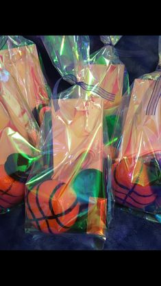 Goodie bags with basketball clementines inside!