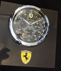 This is a custom wall display piece, designed for the Ferrari collector and Paneristi alike. We took the large dealer display wall clocks available only to Panerai official dealers and mounted them to