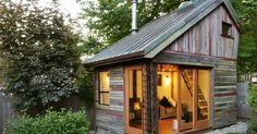 I just want to have this seriously cute little garden shed built from recycled materials.