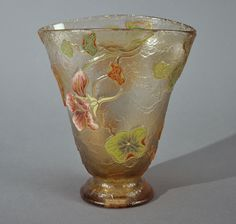 An amber tinted glass vase, acid-etched with polychrome floral motifs on a frosty background.Signed «Gallé». Circa 1900.