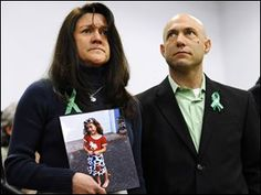 Jennifer Hensel, holding a portrait of her daughter, Sandy Hook School shooting victim Avielle Rose Richman, stands with her husband Jeremy Richman at a news conference at Edmond Town Hall in Newtown, Conn. Read more at http://www.toledoblade.com/Nation/2013/07/14/Parents-of-Newtown-victim-search-for-answers.html#3rEJkmQvgqO8LBJW.99