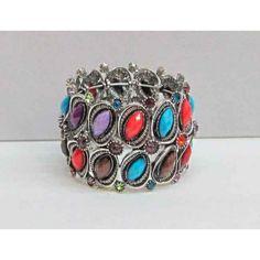 Bracelet élastique de couleur argent avec pierre multicolores.