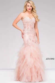 Strapless mermaid fully embroidered prom dress in blush color with corset sheer bodice and sweetheart neckline and tiered skirt.