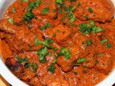 Masala Indian Kitchen's Butter Chicken - boneless pieces of chicken thighs and legs marinated in a mixture of yogurt, mild spices and herbs then barbequed to perfection are coated in a rich and creamy tomato sauce. This dish is gluten-free. Halal Recipes, Curry Recipes, Indian Food Recipes, Real Food Recipes, Chicken Recipes, Ethnic Recipes, Indian Pickle Recipe, Baked Drumsticks, Indian Butter Chicken