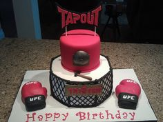 UFC cage fighting cake.  Gloves are also cake.  J wants an MMA cake for this birthday