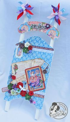 This is a beautiful altered sled from @Gloria Stengel! She used Nutcracker Sweet and @Petaloo International flowers to make this treasure! #graphic45 #petaloo