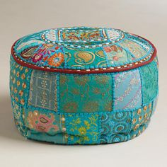 Made of recycled fabric with vibrant Indian patchwork, our exclusive Small Turquoise Pouf brings both color and comfort to any room.
