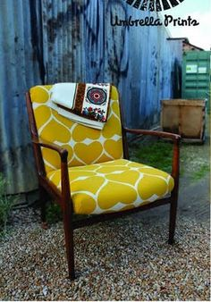 fun re-upholstered chair love the fabric maybe a different color tho