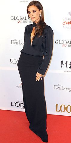 Victoria #Beckham in plunging #black silk top and floor-length black skirt (from her own line)