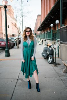 Four Ways To Style A Fancy Dress: One of the ways I styled this green satin handkerchief midi dress is with a grey ribbed mock turtleneck sweater layered underneath. Not only does it keep you warm, but it also adds another bit of dimension to your outfit. It's also a great alternative if you want a more modest look on top. Check out the other 3 ways I styled it in the full post!