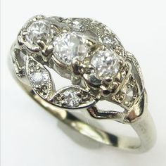 Sweet Leaf: A delicate arrangement of diamond set leaves surround a floating trio of chunky antique diamonds. Openwork side panels create a lovely arching form on the finger. Ca. 1935. Maloys.com