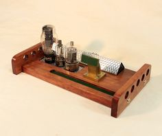 The First in The NEW series WIreless Music Station....Nothing out there like it...- Looks like an old Radio... Special Deluxe Model with old Vacuum Tubes ... Vintage look with Engine Turned - Solid Cherry    Yea it looks kind of weird, But what it does is too Cool.. Its a wireless hookup for your...